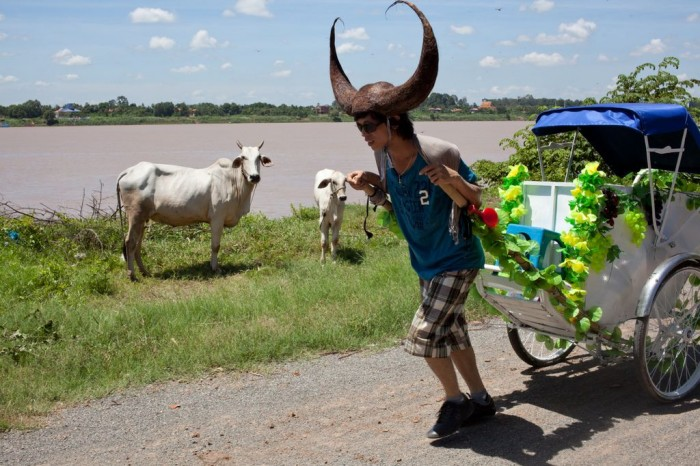 Khvay Samnang, Samnang Cow Taxi Moves Sand, Phnom Penh, 2011, Performance, Courtesy of the Artist